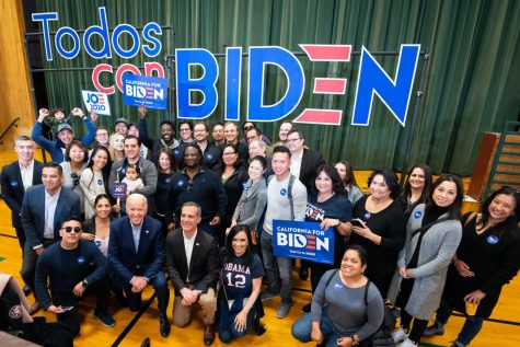 President Elect Joe Biden poses with supporters from Todos con Biden.