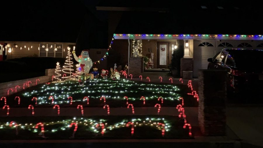 A+house+in+Tustin%2C+Calif.+is+fully+decorated+with++colorful+lights+surrounded+by+lit+up+candy+canes.+Photo+taken+at+6%3A47+p.m.+on+December+1%2C+2020.