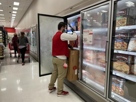 Senior, Adrian Gonzalez restocking perishables  at Target in Santa Ana. Photo taken Sunday, Feb. 7, 2021 at 2:47 p.m.