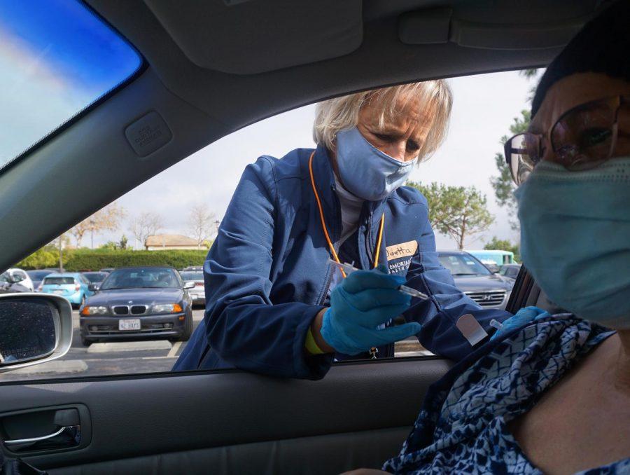 Lynn Maharaj, receives her first dose of the COVID-19 vaccine at Soka University in Aliso Viejo. Photo taken Feb. 9, 2021.