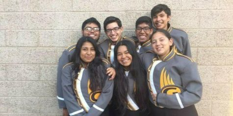 Senior, Michael Martinez (top center), poses alongside fellow marching band members as they celebrate the end of a successful season with a photoshoot during his junior year.