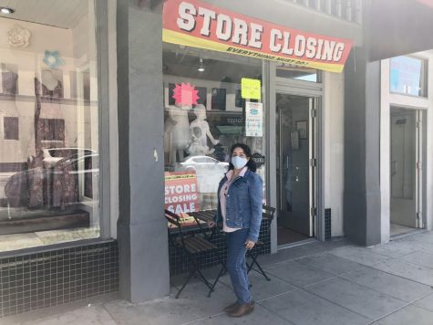 Owner Lilia Cerpas poses in front of Genesis Bridal Boutique located in Downtown Santa Ana on 4th Street at the entrance of her store.  Photo taken March 22, 2021.