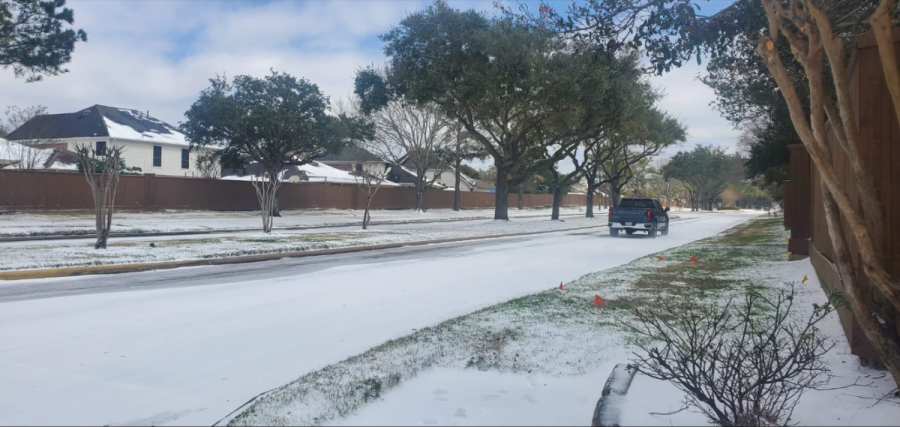 Photo taken by Edgar Rios of the snow that accumulated on a road in Houston, Texas, in front of Ergard Rios' house on Feb. 20, 2021.