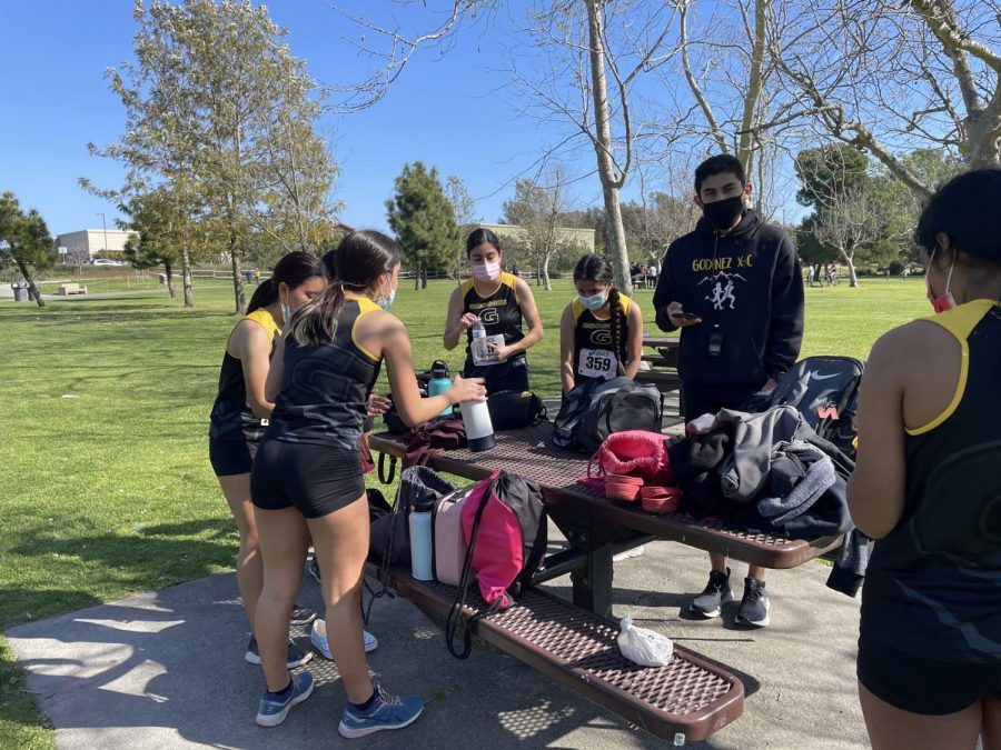 Girls cross country team preparing for their mile cool down after their race. Photo taken March 18, 2021 at 3:41 p.m.