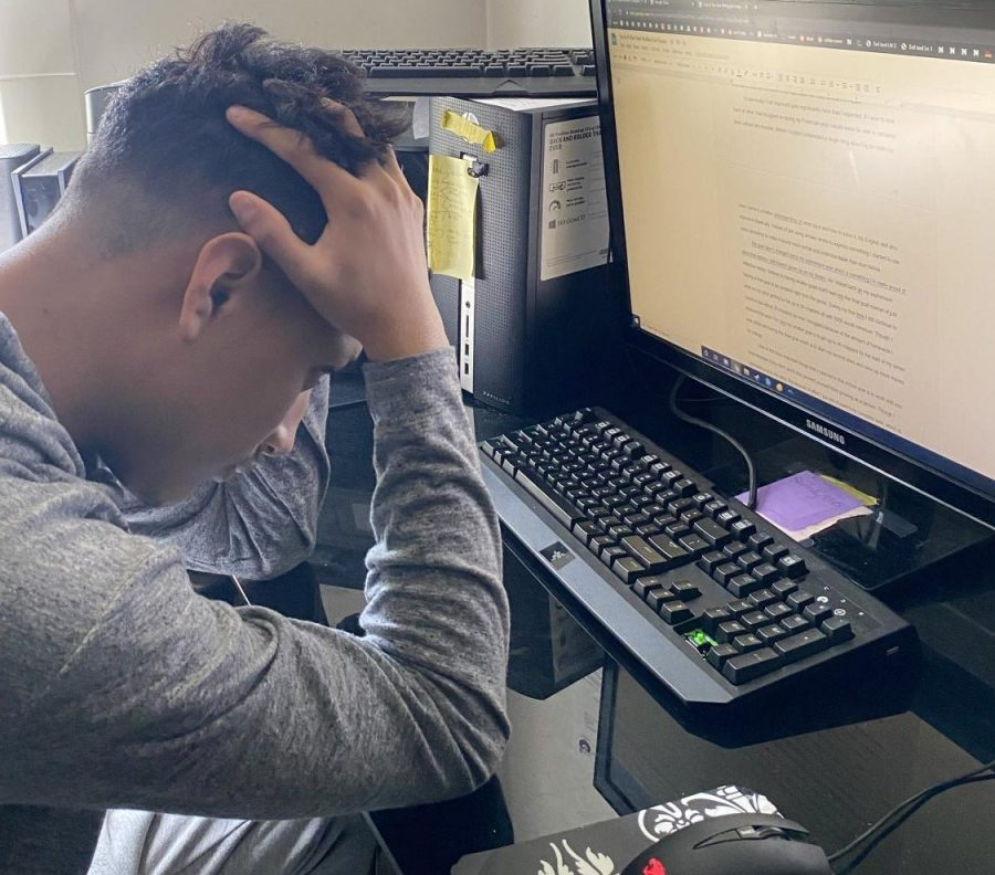 Opinions writer, Erik Pineda, stresses over his screen as he tries to put final edits on another article for the Grizzly Gazette.