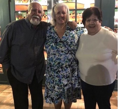 From left to right, Marian's great uncle, Salvador Franco Rizo, her grandma Gloria Franco Rizo, and her great aunt, Maximalia Franco Rizo pose for a picture in front of Ostioneria Bahia Mexican and Seafood restaurant located in Tustin. Photo taken September 24, 2018.
