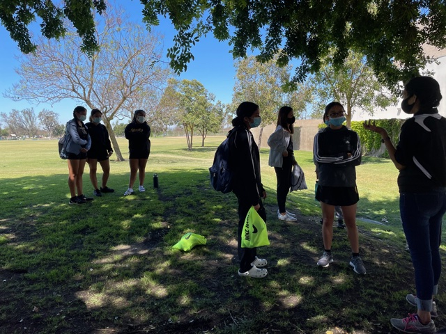 Coach Gaby Valdez talks to the girls track and field team just before they head to race against Segerstrom. Photo taken April 28, 2021 at 1:53 p.m.