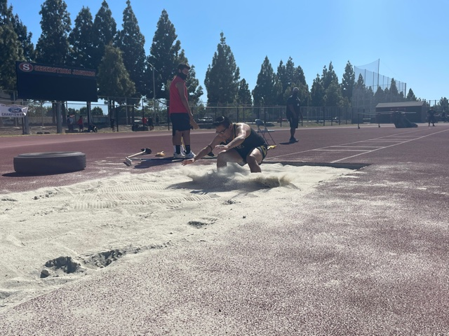 Senior Javier Procopio mid jump on the long jump event at Segerstrom's track. Photo taken April 28, 2021 at 3:46 p.m.