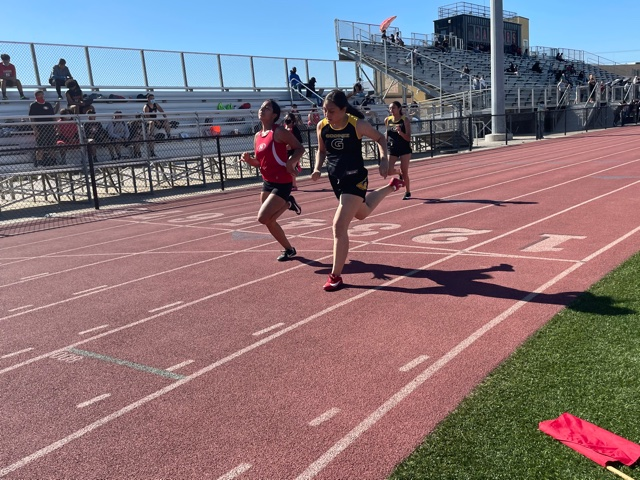 Evy Gonzales (front) and Mariajose Guillen (back) run the junior varsity 100 meter dash at Segerstrom's track. Photo taken April 28, 2021 at 4:27 p.m.