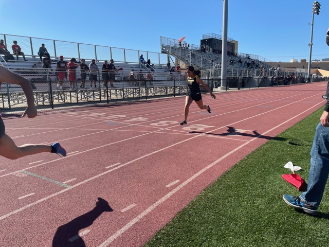 Varsity runner Ashlins Gomez crosses the finish line on the 100 meter dash at Segerstrom's track. Photo taken April 28, 2021 at 4:30 p.m.