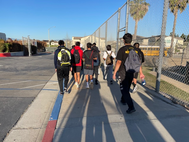 Godinez's boys track and field team leave Segerstrom to board bus after the long race against Segerstrom. Photo taken April 28, 2021 at 6:22 p.m.