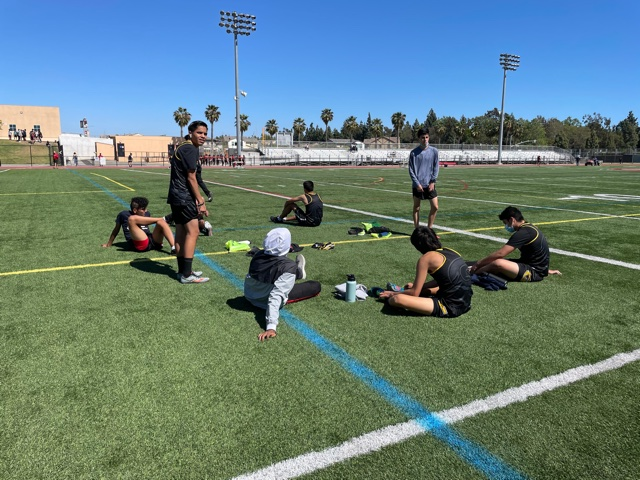 Boy's distance team warm up before they run the 1600 meter event at Segerstrom's track  Photo taken April 28, 2021 at 3:13 p.m.