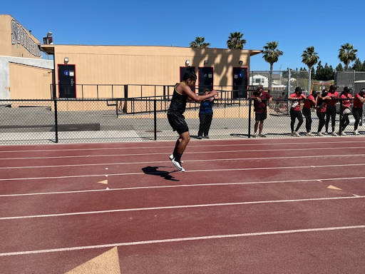 Senior Gabriel Cruz practicing his jumps just before he runs the 100 meter event on Segerstrom's track. Photo taken April 28, 2021 at 3:15 p.m.