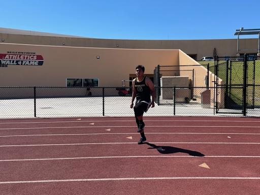 Junior Damian Nieto warms up just before he runs the 100 meter event on Segerstrom's track. Photo taken April 28, 2021 at 3:16 p.m.