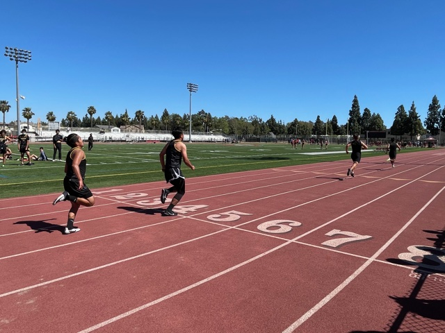Cruz after passing off the baton to Nieto during the 100 meter event on Segerstrom's track. Photo taken April 28, 2021 at 3:17 p.m.