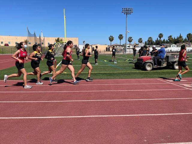 Aylien Garcia (left), Nereida Luna (middle), and Ashley Mendiola (front) run the junior varsity 1600 meter event on Segerstrom's track. Photo taken April 28, 2021 at 3:21 p.m.