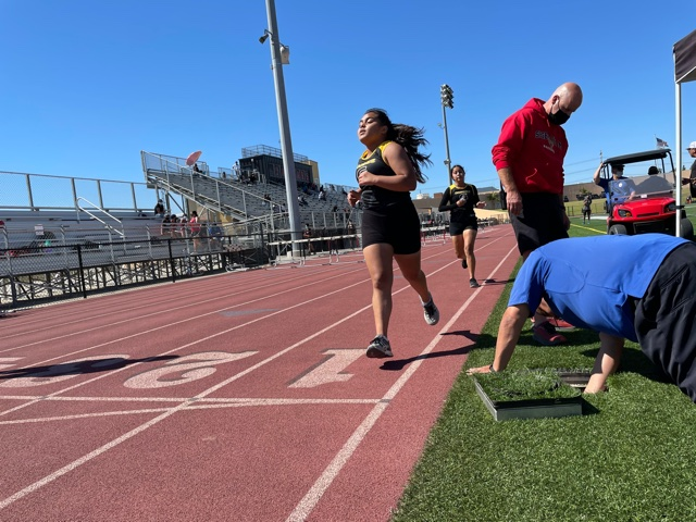 Aylien Garcia (front) and Nereida Luna (back) finish strong on the 1600 meter event at Segerstrom's track. Photo taken April 28, 2021 at 3:27 p.m.