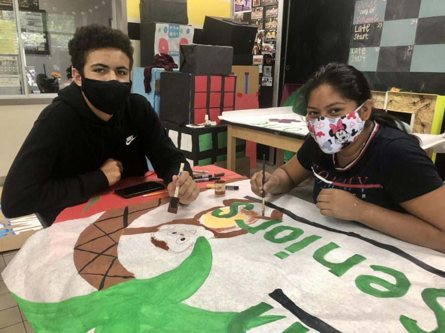 From left, senior, Jesse Church Jr. and junior, America Bernabe, work on a welcome back to school poster in the ASB room at Godinez Fundamental High School, on Wednesday, August 11, 2021.