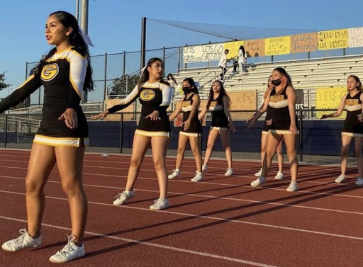 GFHS cheer team cheers for Godinez football players at the rivalry game against Valley High School.